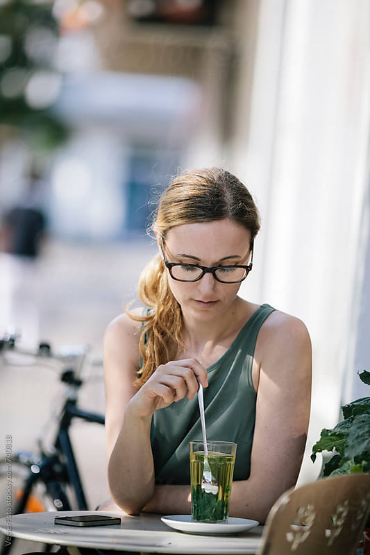 Woman enjoying a break at outdoor Cafe by VegterFoto for Stocksy United