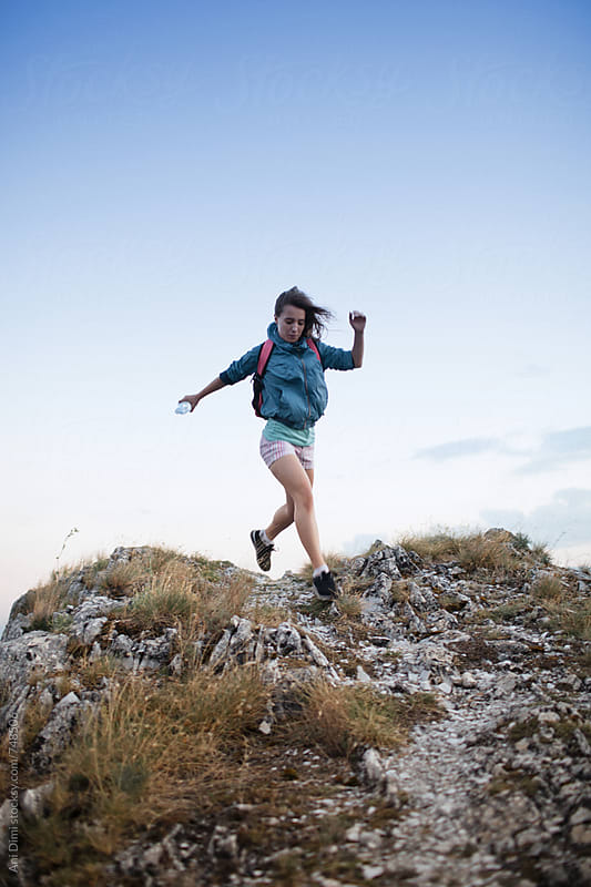 Fit woman trail runner  by Ani Dimi for Stocksy United