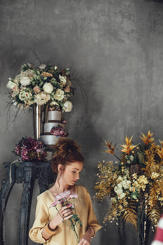 Young Woman Holding a Flower Bouquet by Lumina for Stocksy United