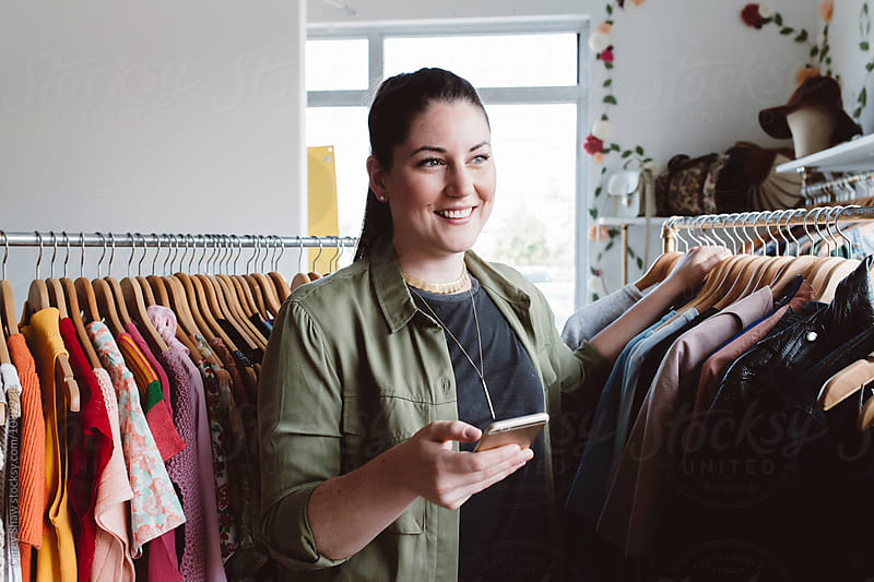 Small business owner using her mobile phone by Carey Shaw for Stocksy United