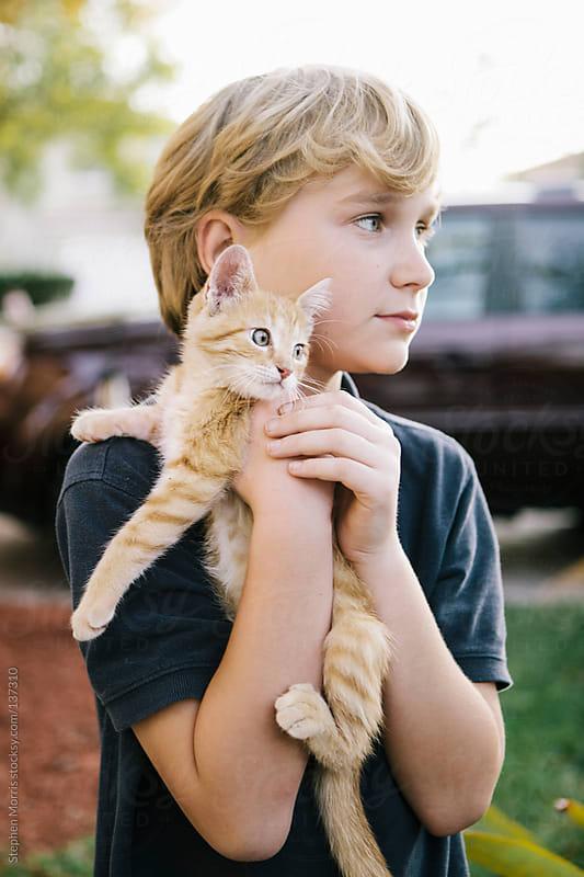 Boy holding Kitten by Stephen Morris for Stocksy United