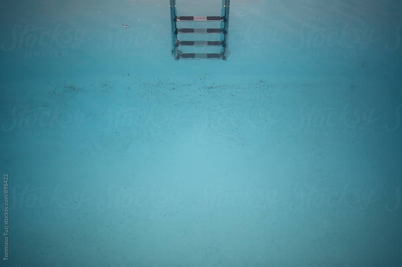 Stepladder in swimming pool by Tommaso Tuzj for Stocksy United