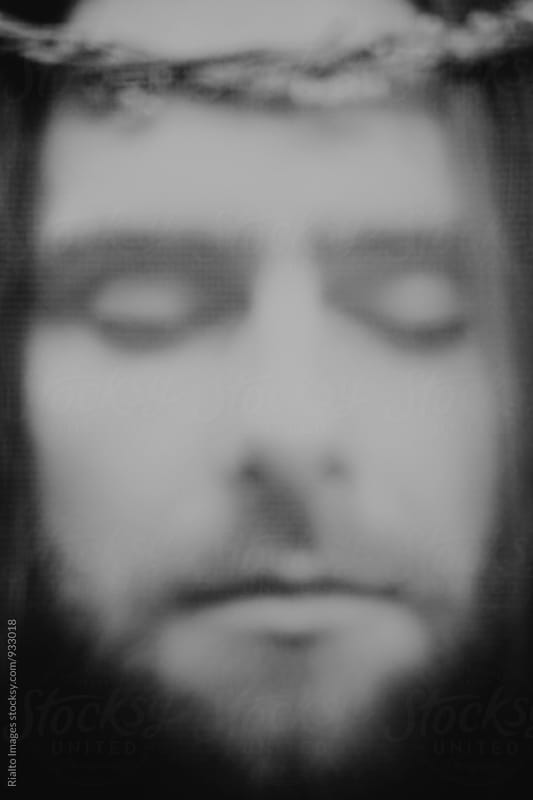 Close up of man resembling Jesus Christ, eyes closed
