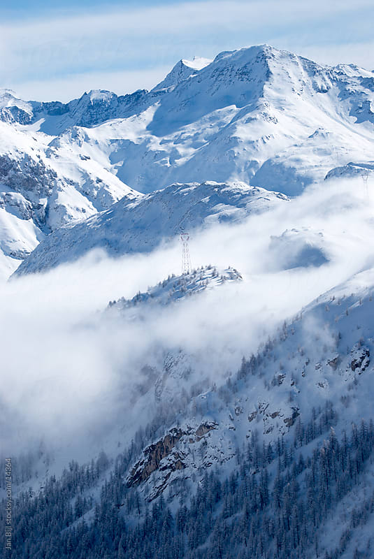 snow mountains, french alps by Jan Bijl for Stocksy United