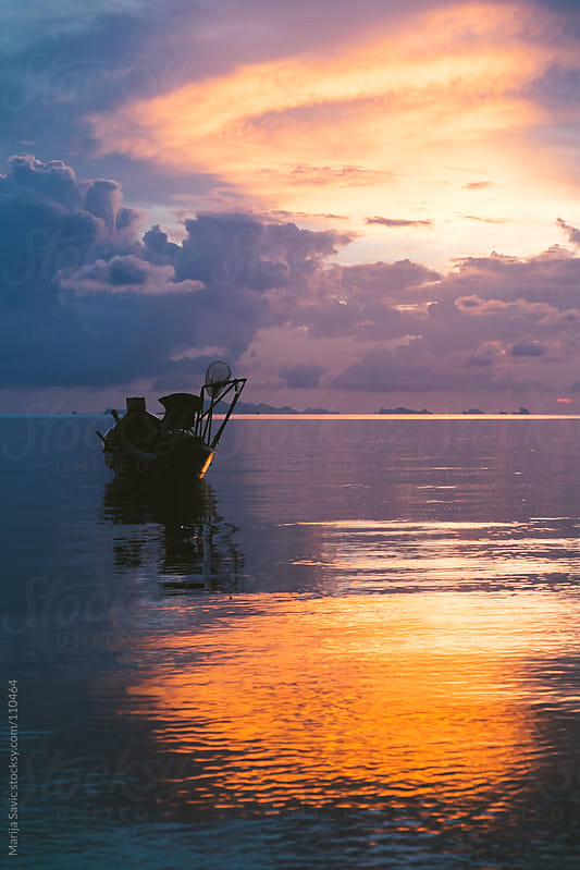 Lonely boat and beautiful sunset. by Marija Savic for Stocksy United