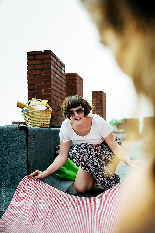Young woman preparing a picnic by VegterFoto for Stocksy United