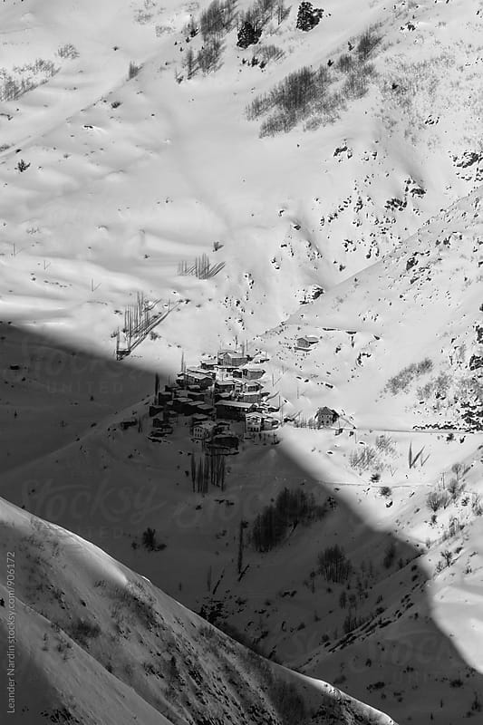 small remote village in snowcovered mountain landscape in east anatolia, turkey - black and white by Leander Nardin for Stocksy United