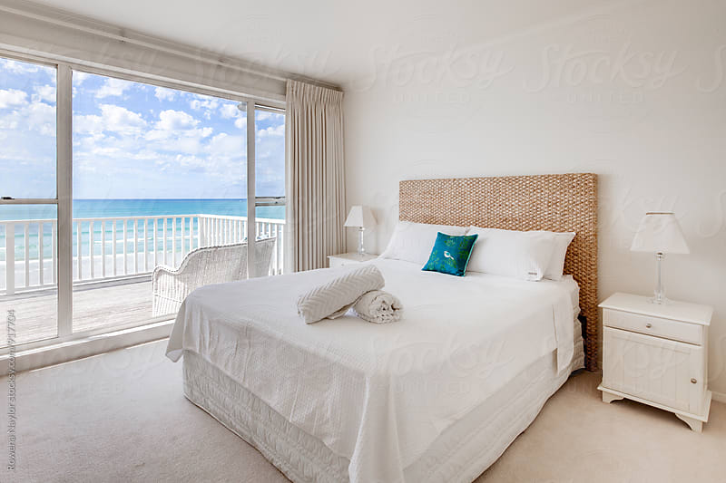 Bedroom with an ocean view by Rowena Naylor for Stocksy United