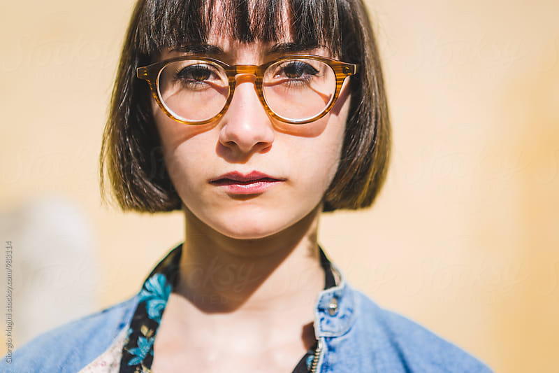 Portrait of a Nerdy Young Woman Posing Serious by Giorgio Magini for Stocksy United