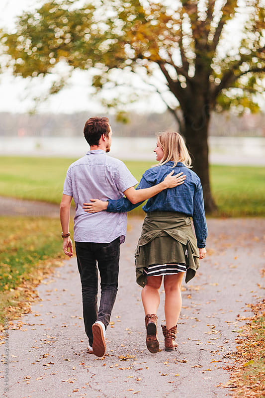 A Cute Young Couple Walking Down a Path by B. Harvey for Stocksy United