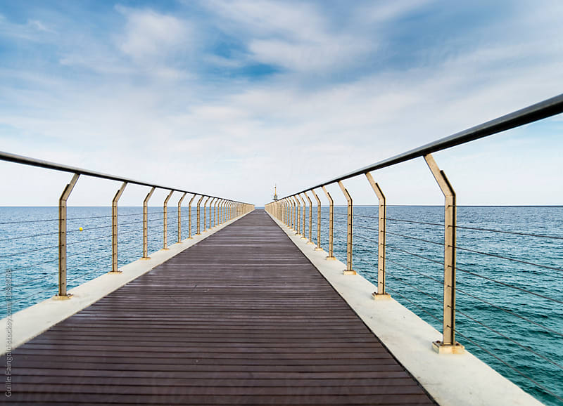 Endless pier leading to sea by Guille Faingold for Stocksy United