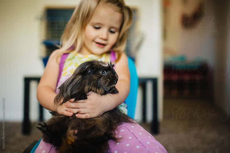 Her First Pet by Jessica Byrum for Stocksy United