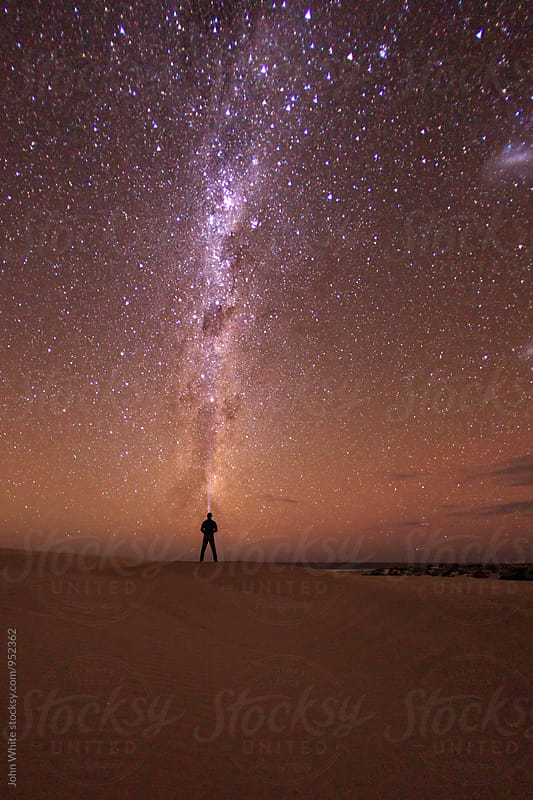 Man looking up at the Milky Way at Sleaford Bay. Eyre Peninsula. South Australia. by John White for Stocksy United