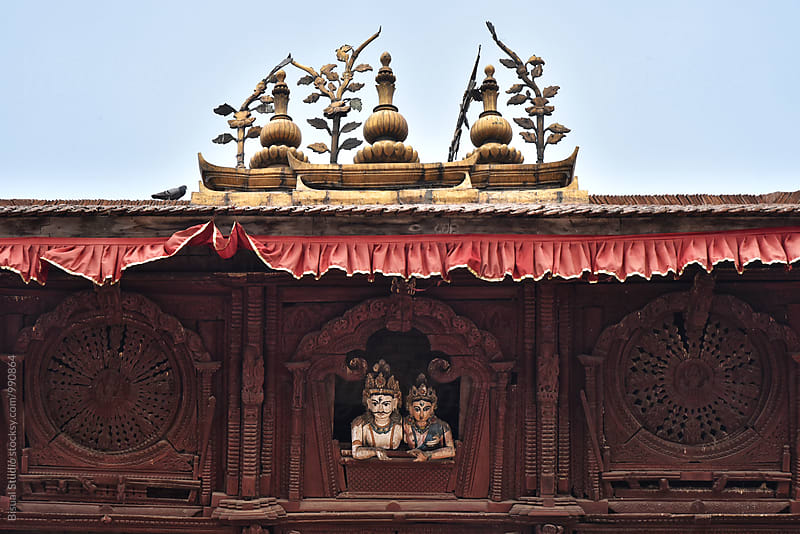 Shiva and Parbati in a window, Durbar Square by Bisual Studio for Stocksy United