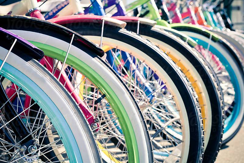 Rows of colorful cruiser bikes for sale by Carolyn Lagattuta for Stocksy United