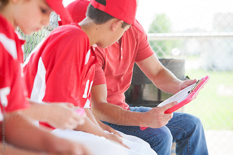 Baseball: Checking Out The Game Lineup by Sean Locke for Stocksy United