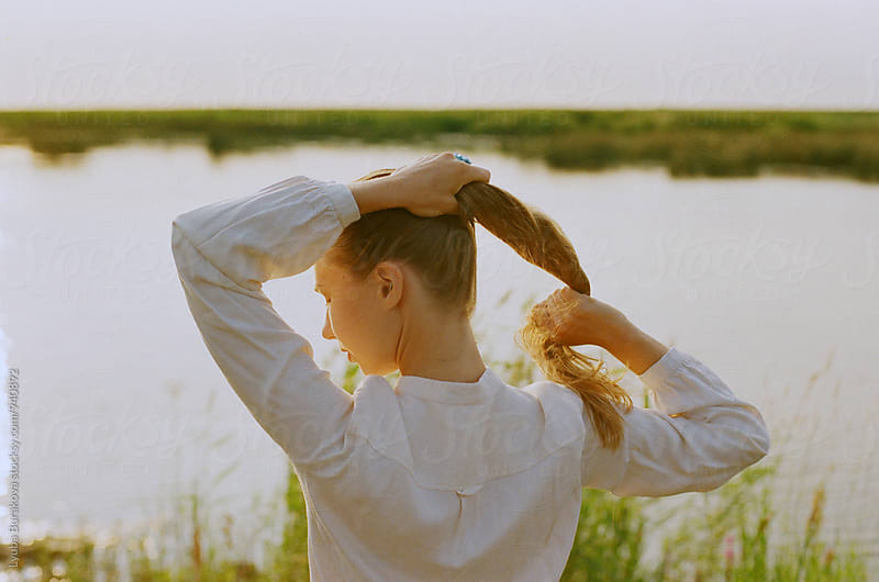 Woman at the sunset by Lyuba Burakova for Stocksy United
