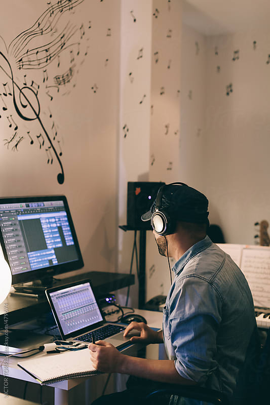 Young Man Producing Music in His Home Sound Studio by VICTOR TORRES for Stocksy United
