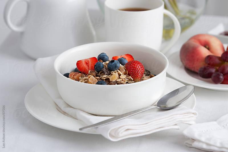 muesli and fresh fruit breakfast by Lee Avison for Stocksy United