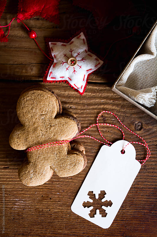 Gingerbread man cookies and Christmas tag by Pixel Stories for Stocksy United