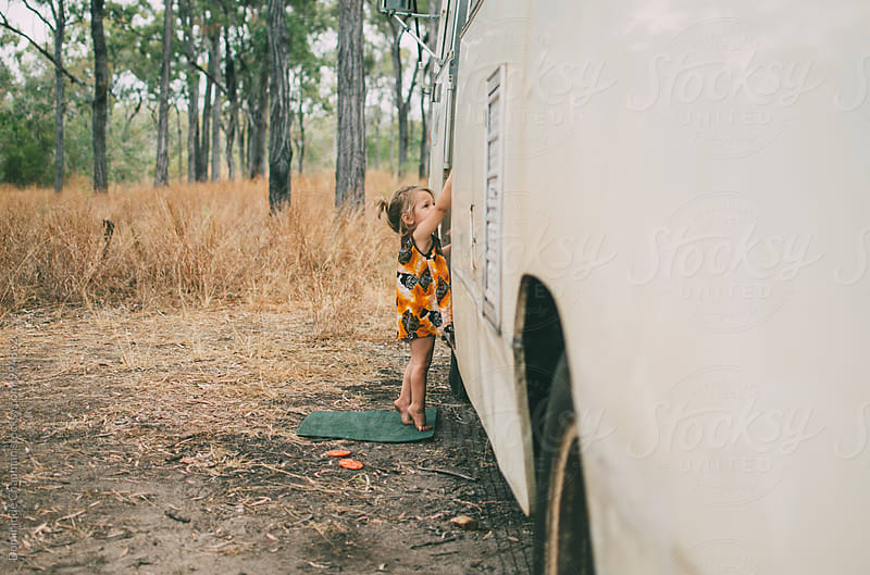 Little girl reaching to bus door by Dominique Chapman for Stocksy United