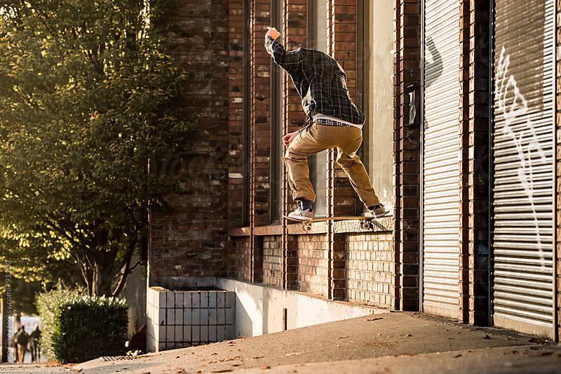 Skateboarder tricks at street by Jara Sijka for Stocksy United