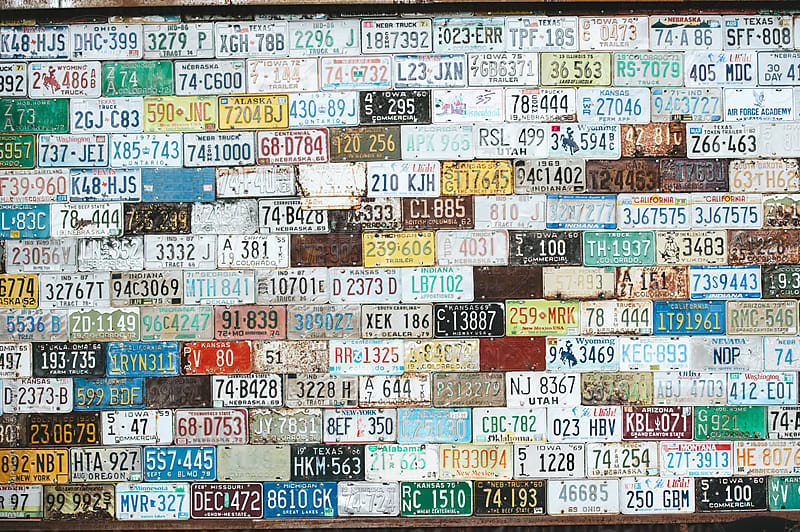 license plate wall by Beth Johnston for Stocksy United