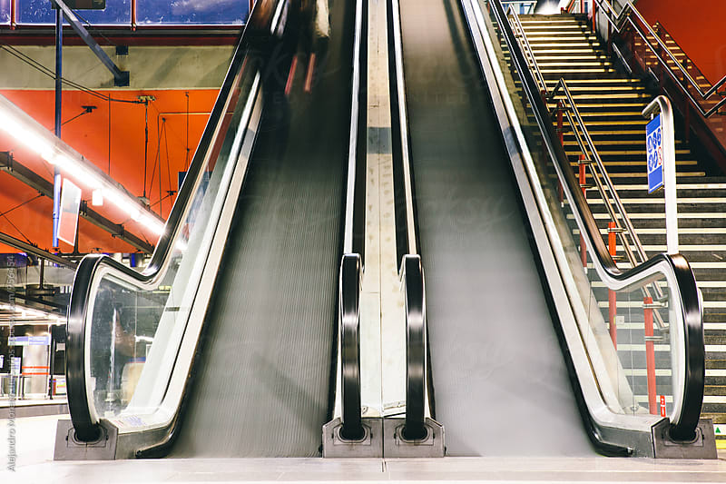 Subway escalators in motion by Alejandro Moreno de Carlos for Stocksy United
