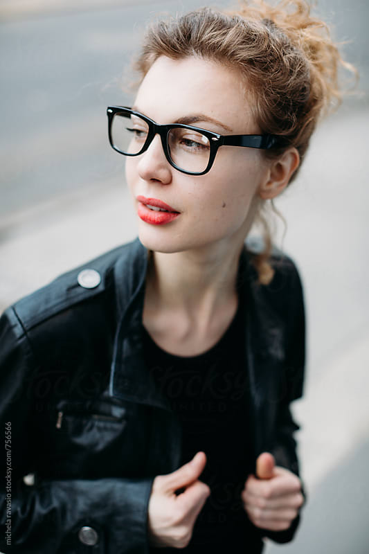 Beautiful woman with red lips and glasses by michela ravasio for Stocksy United