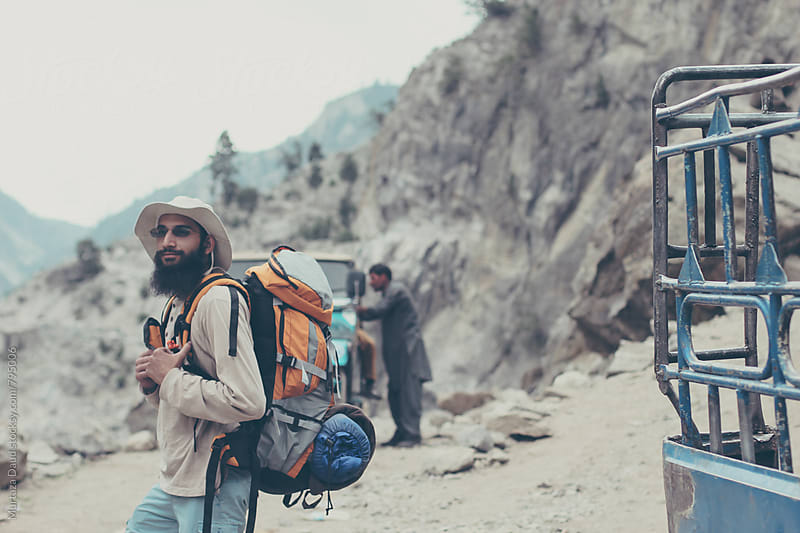 A backpacker starting an adventure by Murtaza Daud for Stocksy United