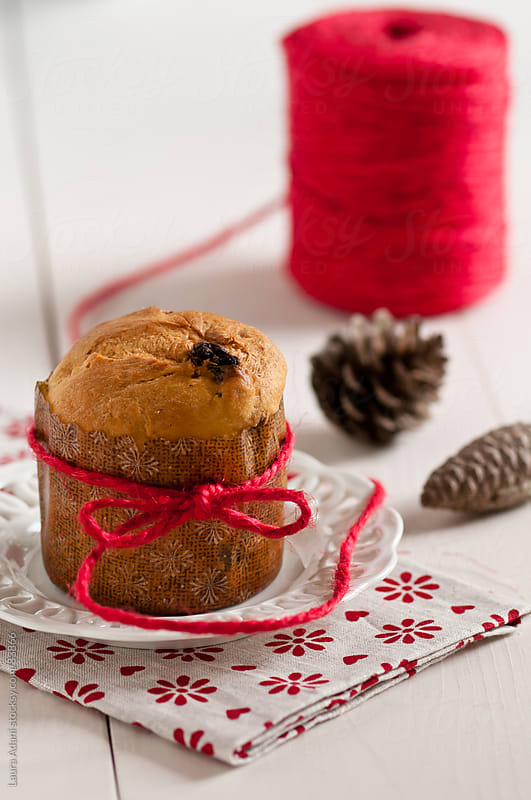 small panettone tied up by a red thread by Laura Adani for Stocksy United