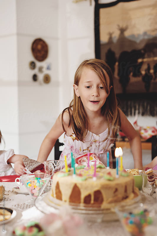 birthday girl with cake, 8 years old by Gillian Vann for Stocksy United