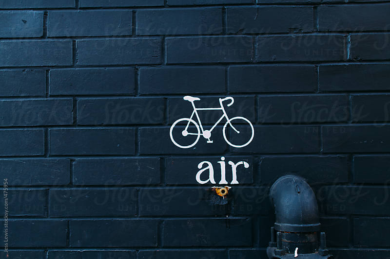 sign advertising air for bicycles by Jess Lewis for Stocksy United