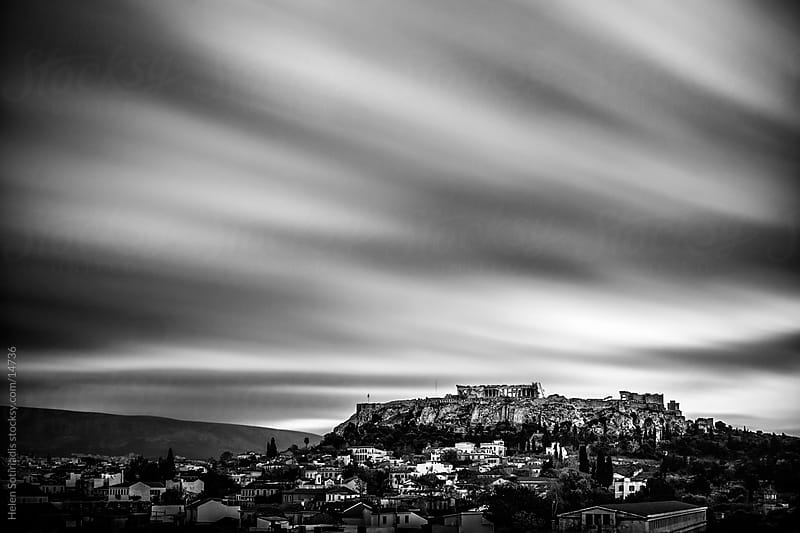 athens cityscape with the acropolis and clouds by Helen Sotiriadis for Stocksy United