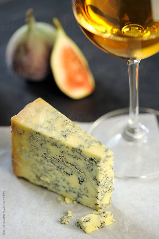 Stilton cheese and white wine by Ina Peters for Stocksy United