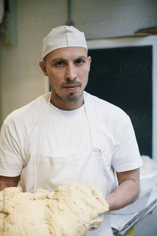 Portrait of a baker by Miquel Llonch for Stocksy United