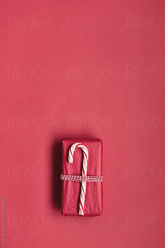 christmas gift with candy cane wrapping by ruth black