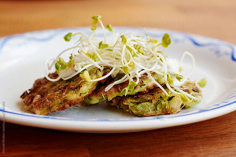 Zucchini fritters by Harald Walker for Stocksy United