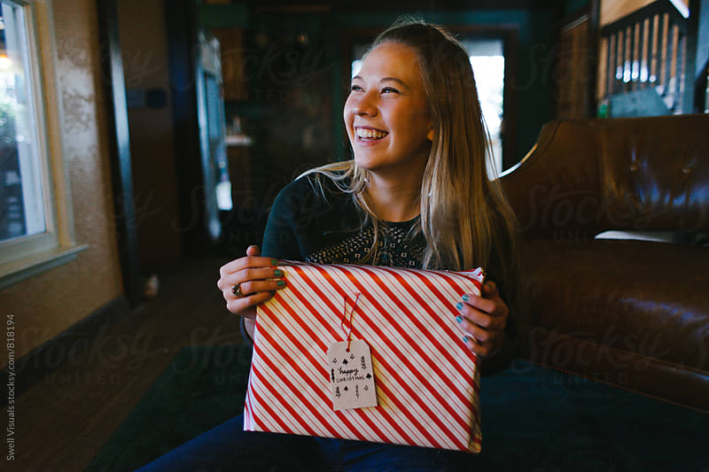 Blonde Girl Wraps Christmas Presents by Caleb Thal for Stocksy United