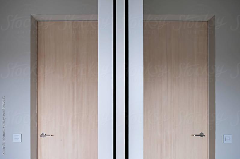 2 doors . symmetry by Koen Van Damme for Stocksy United