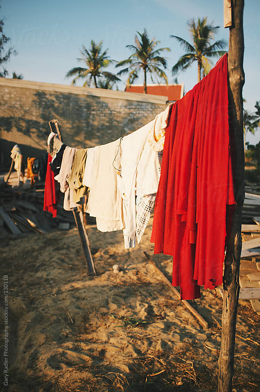 Clothes line, Vietnam. by Gary Radler Photography for Stocksy United