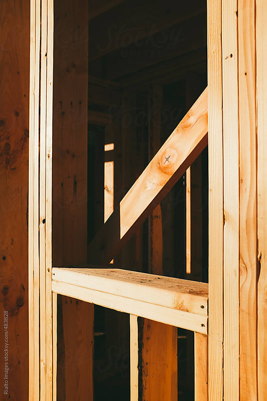 Wood framing of house under construction by Paul Edmondson for Stocksy United