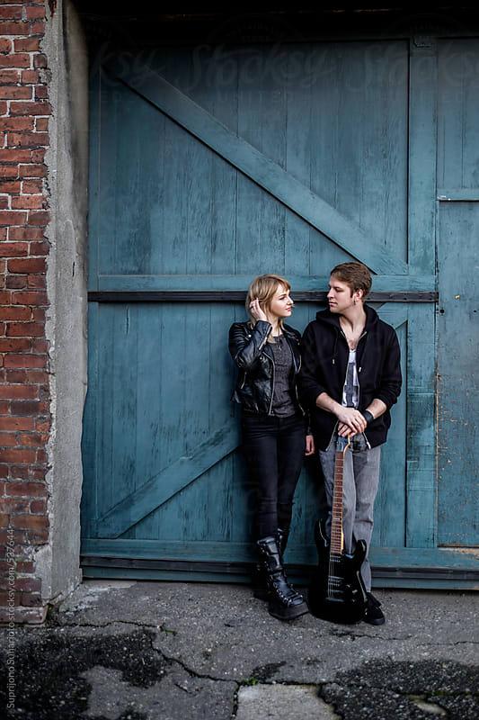 Rocker couple standing on a sidewalk  by Suprijono Suharjoto for Stocksy United