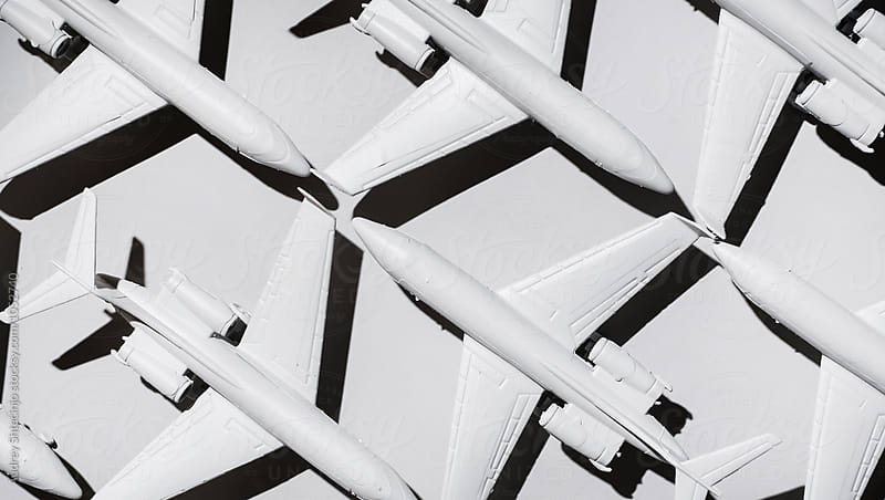 White airplane/jet formation on white background/miniature by Audrey Shtecinjo for Stocksy United