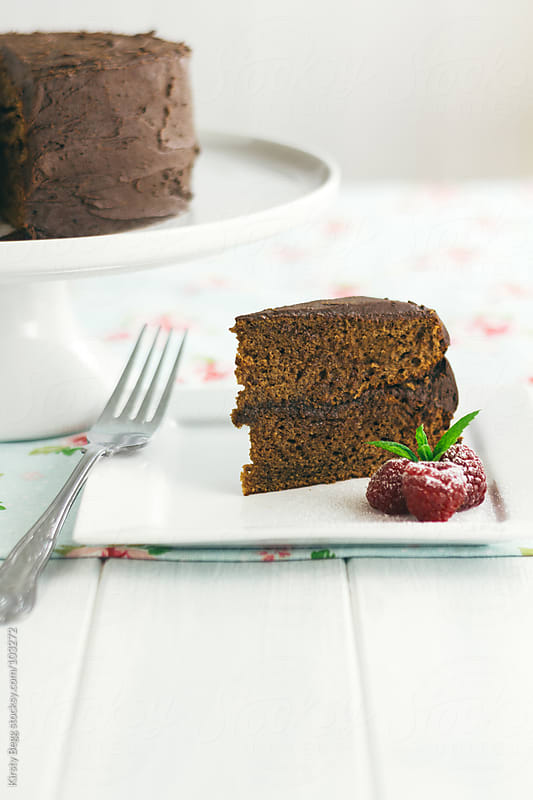 Slice of chocolate cake with copy space in foreground by Kirsty Begg for Stocksy United