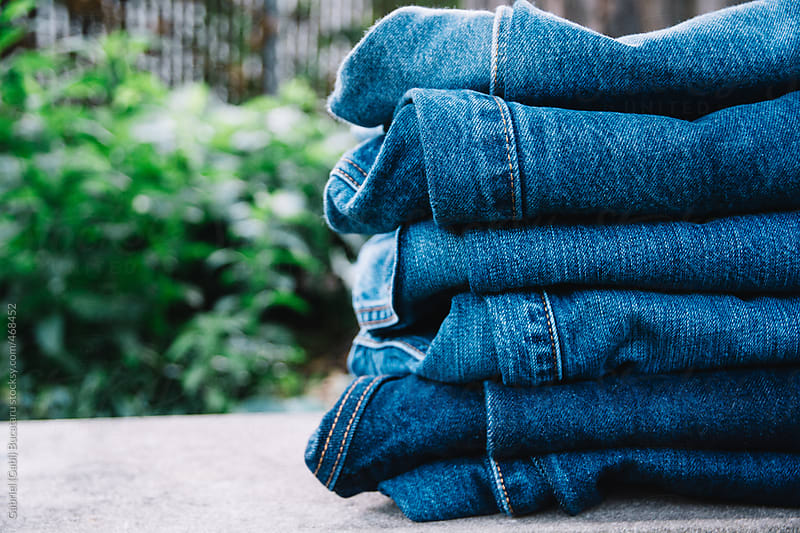 Stack of blue jeans by Gabriel (Gabi) Bucataru for Stocksy United