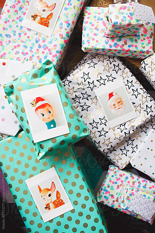 Christmas presents with colourful wrapping and cards by Natalie JEFFCOTT for Stocksy United