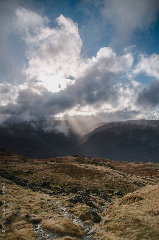 Cloud Bursting with Light by Neil Warburton for Stocksy United
