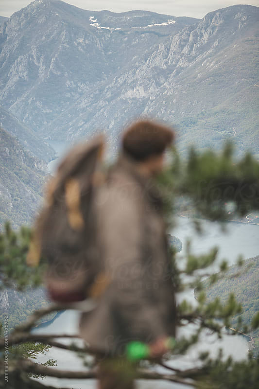 Portrait of a Mountaineer With a Backpack by Lumina for Stocksy United