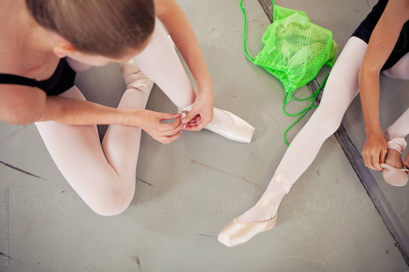 Ballet: Girls Prepping for Pointe Class by Sean Locke for Stocksy United
